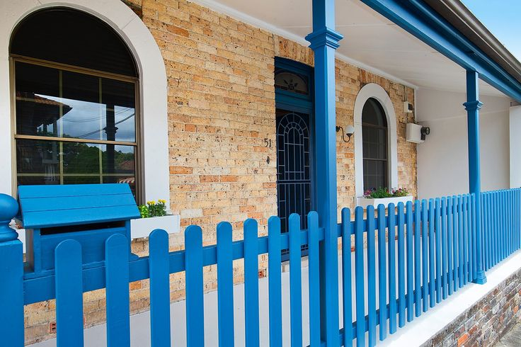 Standstone entrance, blue trim, planter boxes, mailbox, Pilcher Residential