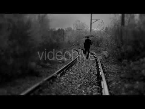 Man with Umbrella Walking on Railroad,black and White Color (Stock Footage)