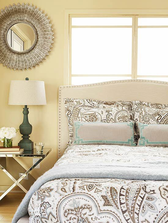 A sunny biscuit hue kicks off this bedroom's comfy neutral color palette. Touches of glam lend a little spark. http://www.bhg.com/rooms/bedroom/master-bedroom/25-of-our-favorite-real-life-bedrooms-/?socsrc=bhgpin122014neutralsparkle&page=8