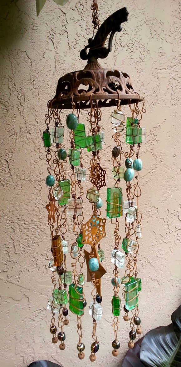 Idea: use sea glass that I've got plenty of at home, wire it, hang it! :D  Rust in the Wind Windchime