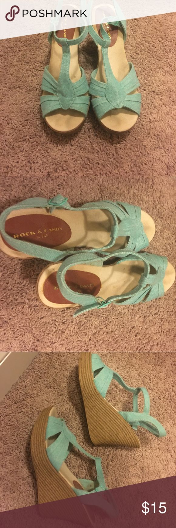 Teal wedge sandals These wedges are teal canvas with faux wood heel.  Worn but in good condition.  No scuffs on heels. Rock & Candy Shoes Wedges