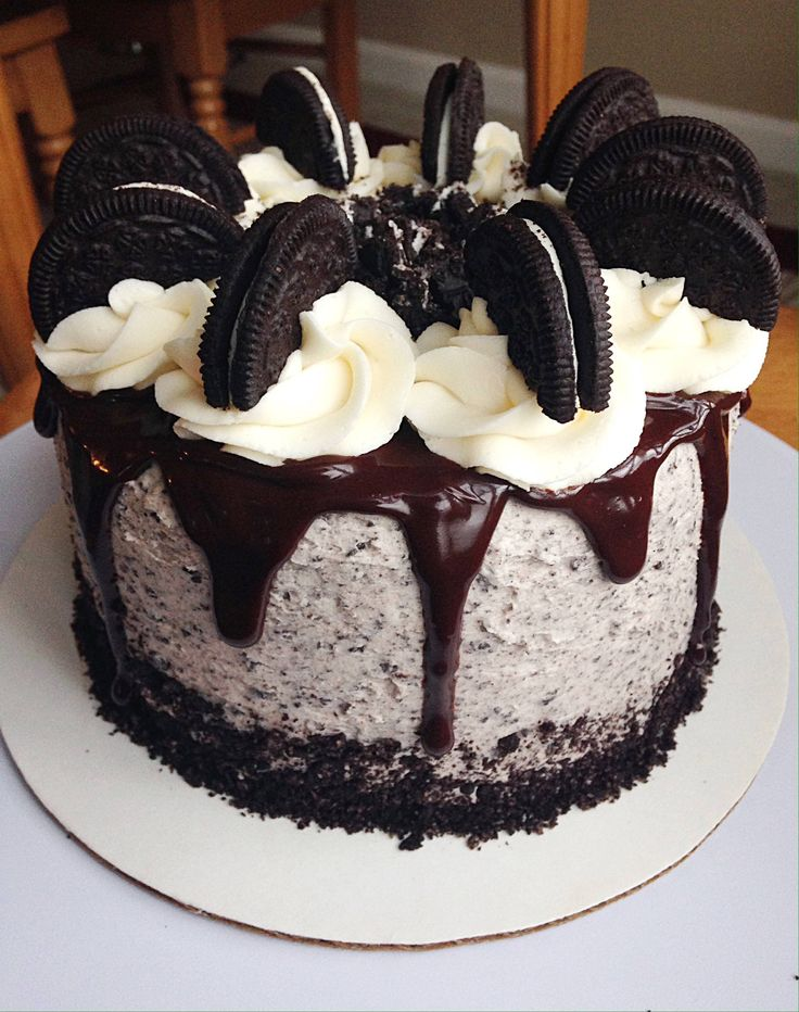 [OC] Cookies & Cream Cake! It consists of Devils food Cake cookies & cream buttercream semisweet chocolate ganache Oreo crumbs and vanilla buttercream. [x-post from /r/baking]