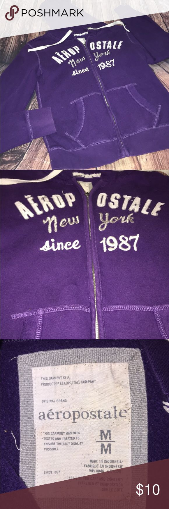 Aeropostale purple zip up hoodie size medium Aeropostale deep purple zip up hoodie size medium. 22 in long, 16 in wide, 23 in sleeves.   I am open to reasonable offers, I ship within 48 hours of purchase, most of the time sooner. I also offer a 15% bundle discount with 3 or more items and will also send you an additional discounted offer if you create a bundle. Items $10 and under are priced firm unless bundled. I am a non smoking household. Happy poshing! 👗👠👜💄 Aeropostale Tops…