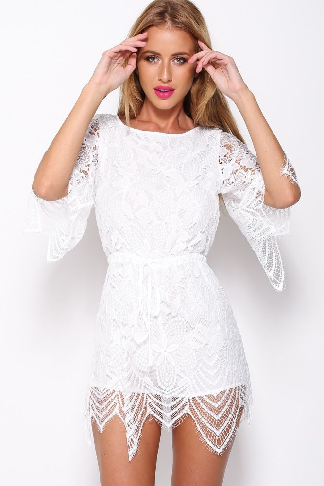 White lace jumper style with shorts designed to look like a skirt.