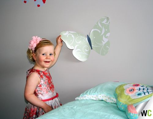 Elise installing one of her new butterflies - she was delighted to be involved in the installation!