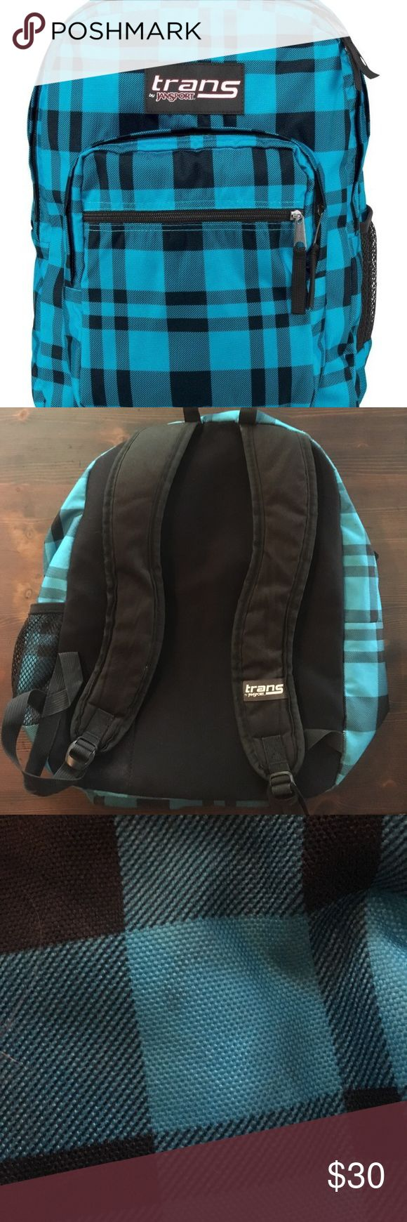 Blue plaid Trans Jansport Backpack Great condition just is a little worn on the bottom with a stain has four pockets has just a few stains shown in pics that I can easily clean once purchased only used less than a year no trading Jansport Bags Backpacks