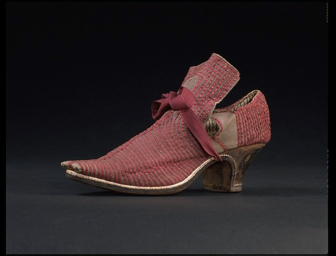 """Shoes in the 17th and 18th centuries were highly decorative. The narrow square toe and shaped heel is typical of the 1670s. The tongue and latchets (straps) have small holes, through which to draw a ribbon to fasten the shoe. While buckle fastenings were coming into fashion for men's shoes at this time, most women continued to tie their shoes with ribbons."" Via Peachy."