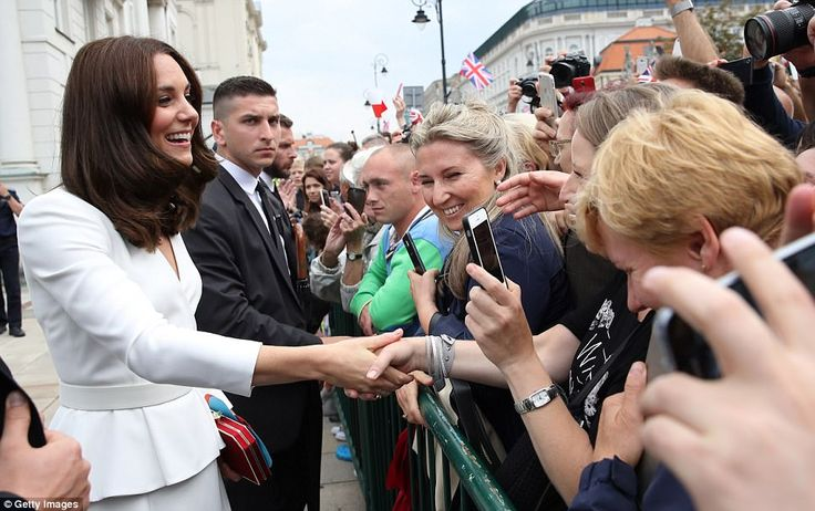 Kate shakes hands with wellwishers during a walkabout outside the Presidential Palace in Warsaw on day one of the royal visit to Poland