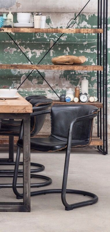 Industrial Dining Chairs  Our urban style industrial dining chairs are available in black or brown leather and showcase the winning combination of vintage style and modern day design perfectly. These stunning chairs boast of cutting edge beautiful mixed with our industrial dining table.