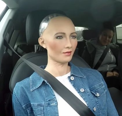 Sophia, the incredibly life-like humanoid robot from Hanson Robotics, took a ride in an Audi A7 self-driving car. Watch the ride and hear Sophia's opinion on autonomous driving.
