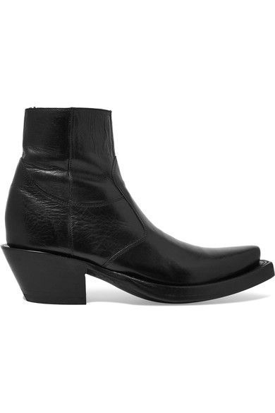GABRIELLE'S AMAZING FANTASY CLOSET | Vetements has teamed up with Texan cowboy boot brand Lucchese to create a collection of Western-inspired boots. This Black Ankle Boot has a slanted Cuban Heel and a traditional snip toe. | You can see the rest of the Outfit and my Remarks on this board. - Gabrielle