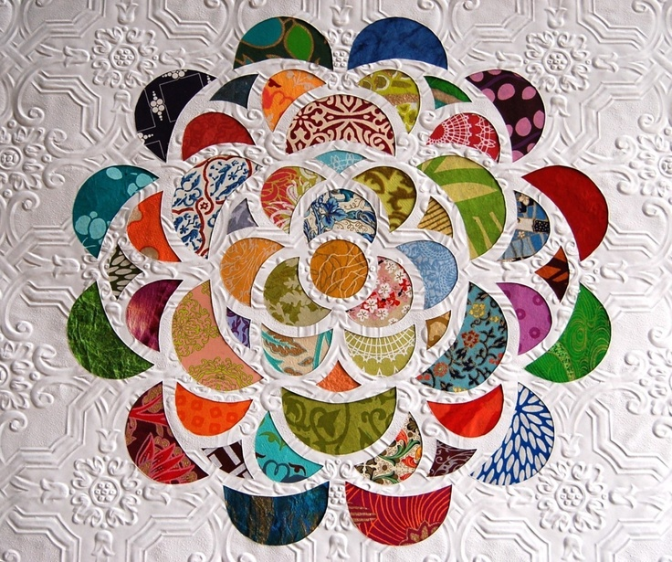 I'd love to try something similar to this: This piece is made by hand cutting the floral design into a beautifully detailed white texture wallpaper with an exacto knife. The colorful papers that appear through each window are handmade papers from different countries including India, Thailand, Italy and Japan. This wall art has loads of texture and depth. 18 inches x 18 inches