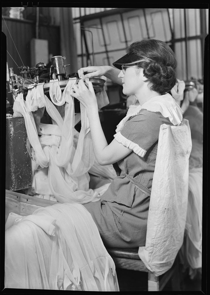 Woman draping stockings at the Minnesac Mills in Philadelphia, Pennsylvania, 1936. Photo Credit: Lewis Hine/Works Progress Administration (National Archives/History By Zim)