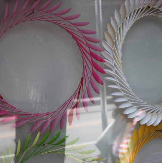 Wreaths of interlocked plastic spoons. Could be a great decoration for wedding receptions, etc.