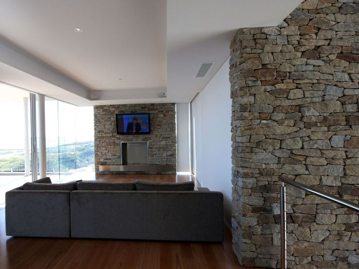 Eco Outdoor Alpine dry stone blade walls and fireplace. Banham Architects | Natural stone flooring / walling | Garden design | Outdoor paving | Outdoor design inspiration | Outdoor style | Outdoor ideas | Luxury homes | Paving ideas | Garden ideas Livelifeoutdoors | Alpine drystone wall cladding