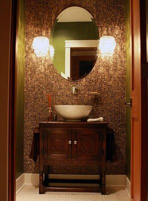 Half Bath With Great Vanity That Has A Bowl Sink And A