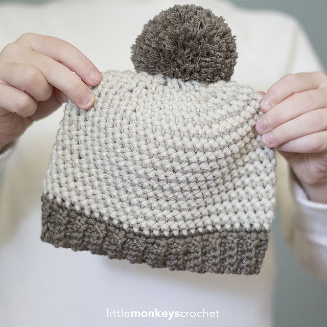 This precious baby hat uses the Herringbone Half Double Crochet stitch as a subtle-yet-welcome change from the typical HDC hat. Add some ribbing and a pom pom for an adorable baby accessory!