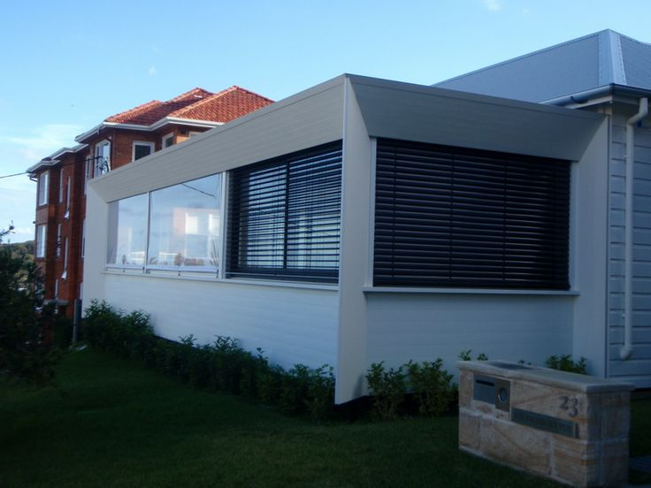 These clear pvc screens look like a glass window but retract right away so the owners can make the most of the cool summer breezes.