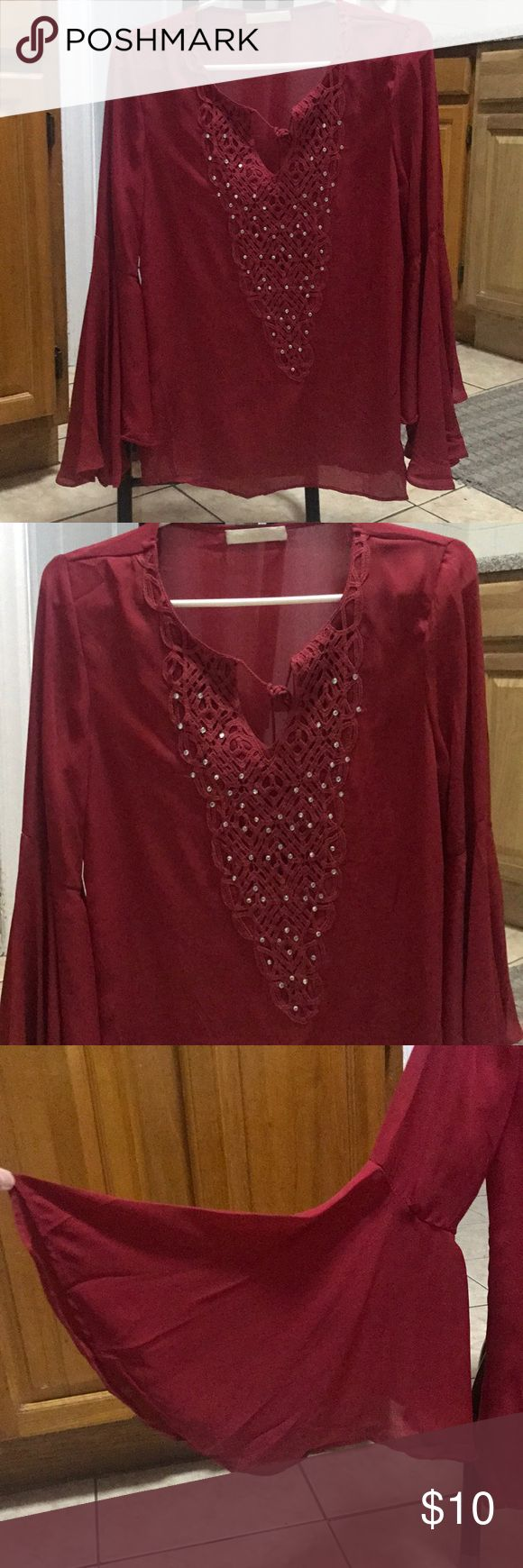 Women's Blouse This is a beautiful red colored shirt with silver diamond embellishments on top. There is a tassel string that connects the from and the shirt has bell sleeves. It's the perfect addition for your Christmas and holiday collection! #red#christmas#festive#holidays#womenswear#blouse#beautiful#fashion Tops Blouses