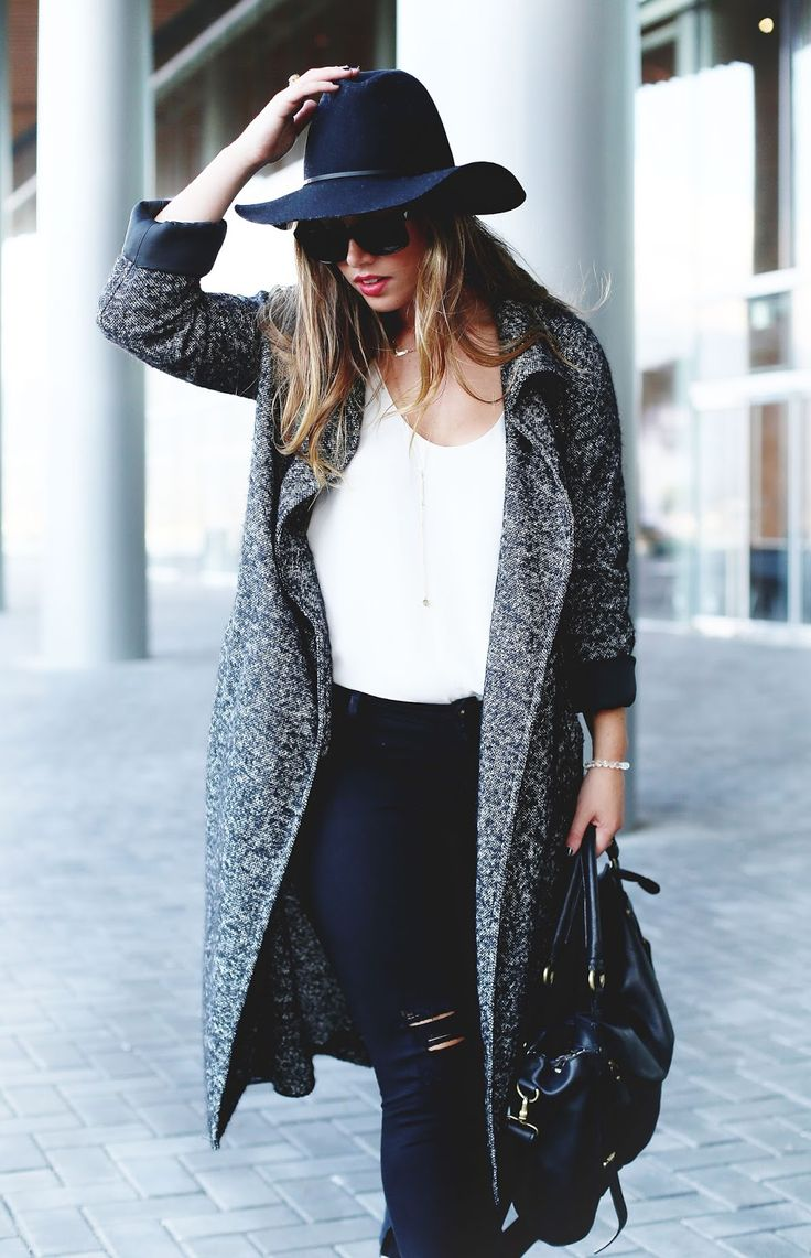 Black floppy hat, ripped black skinny jeans, black leather bag, grey wool trench…