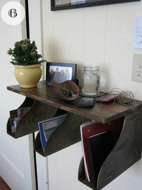 Shelf - Fix some wooden magazine holders to a shelf/piece of wood, stain or paint and you've got a nice storage unit. Place closer together for a work station paperwork organizer.