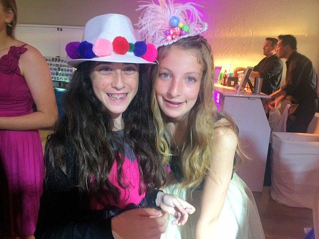Girls making their own candy land themed hats! Candy Land, candy hat, candy land themed hat, candy land party, party hats, party hat ideas, bat mitzvah party ideas, bat mitzvah candy land, sweet 16 party