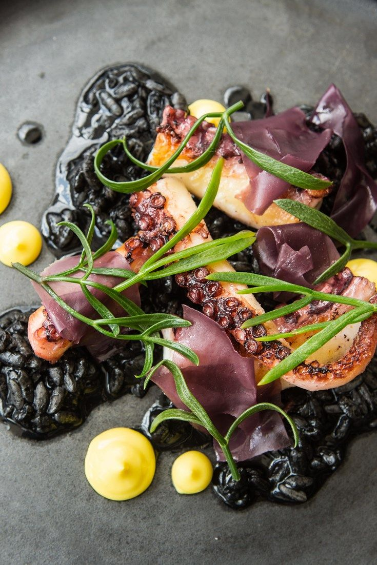 Paul Welburn's striking seafood risotto recipe is topped with pan-roasted octopus.