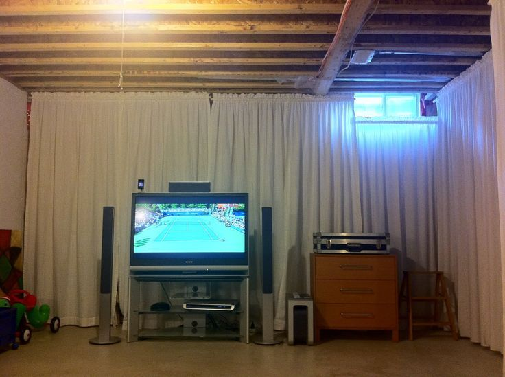 unfinished basement ideas - Tension rods & cheap curtains to test room sizes & places for walls