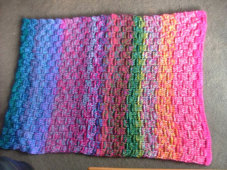 Crocheted basket weave blanket. Very thick - uses 3 strands 8 ply. Good for using up odd balls of wool.