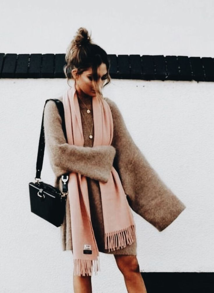 Loose hanging jumper with a thick scarf, looks like such a cozy outfit to throw on for winter. Maybe add some tights if you're in freezing London at the moment! 😘