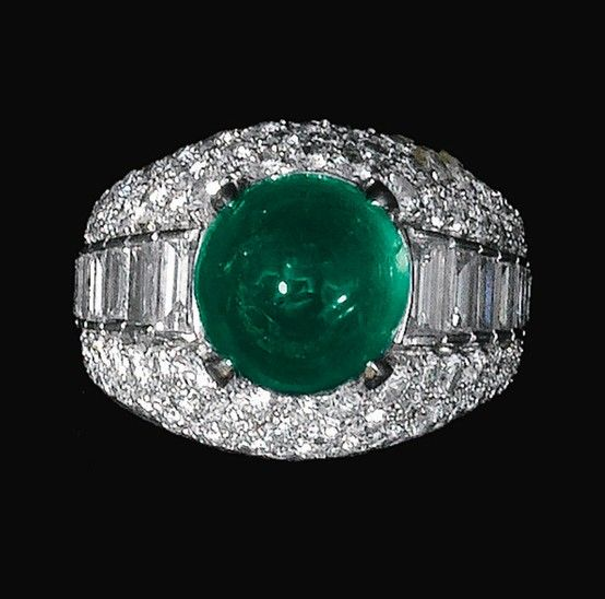 emerald and diamond ring bulgari the bomb mount set with a cabochon emerald and baguette diamonds size signed bulgari