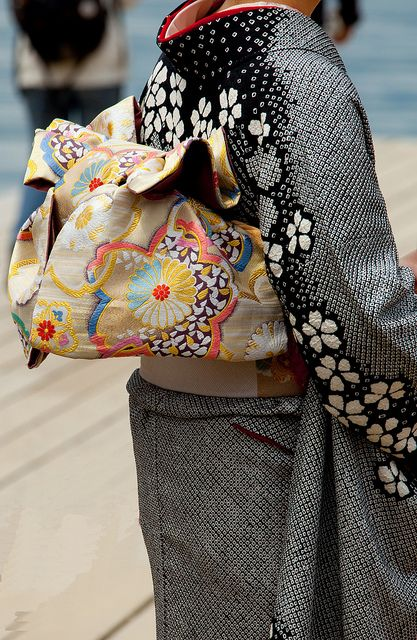 Kimono black Shibori: Detail of an obi- the elaborate back bow on this female wedding guest's costume by Kev Wood.