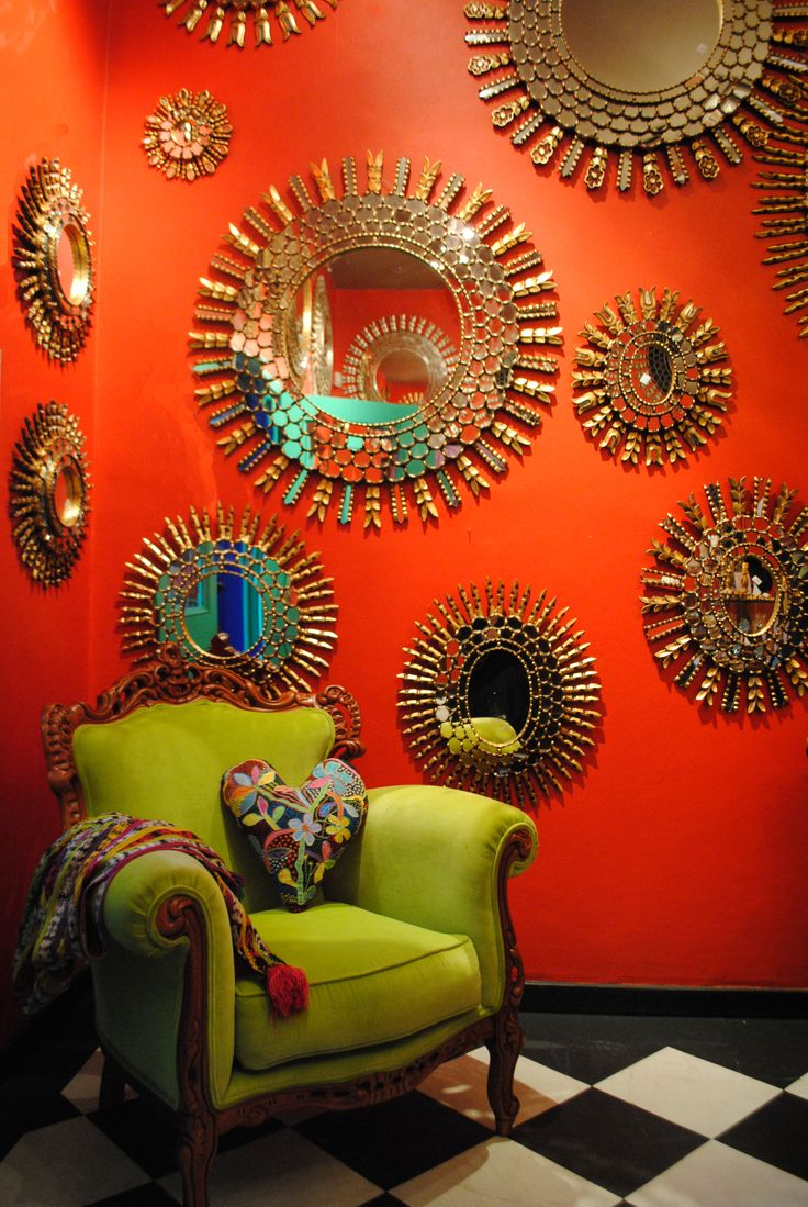 Colorful Display Gold Sunburst Mirrors On Orange Gallery