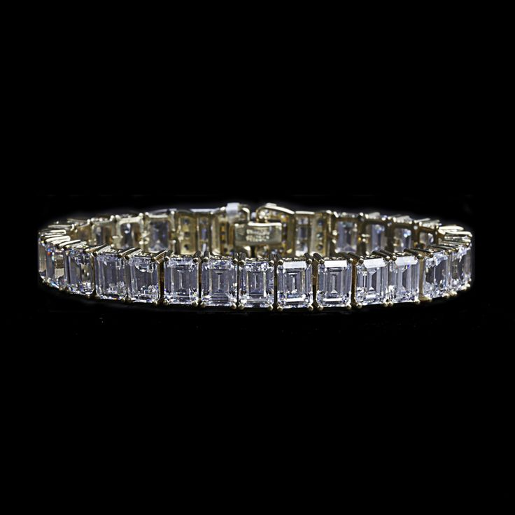 Marilyn Bracelet: Exuding old Hollywood style, this stunning bracelet is set with 25 emerald cut cubic zirconia stones. You will stun any crowd with this sterling silver bracelet in vermeil plating measuring at 7.25