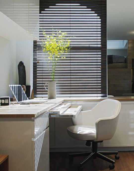 A desk with layers of pull out desk surfaces. So your desk can always look
