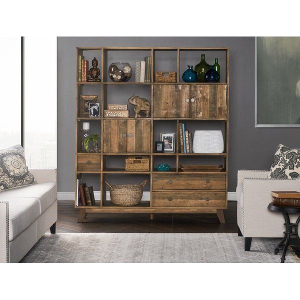 This cube unit is a versatile storage solution made from solid, reclaimed pine. Fitted with shelves of all sizes, along with two cabinets and three drawers, this unit will be sure to meet all your storage and style needs. Outfitted with brass finish pulls and pine wood with a distressed finish, this rustic storage piece will add charm and convenience to any space in your home.