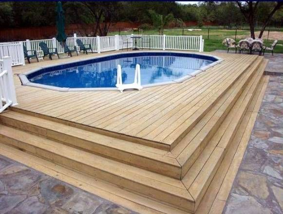 Beautifying an outdoor with above ground pools with decks for Above ground pool house ideas