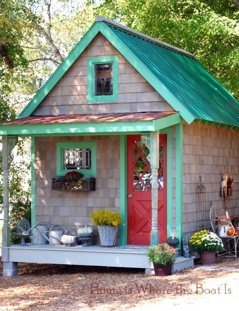fall potting shedthis bold little potting shed gets a full themed costume every season for fall planters of mums and pumpkins galore line its mini porch - Garden Sheds Galore
