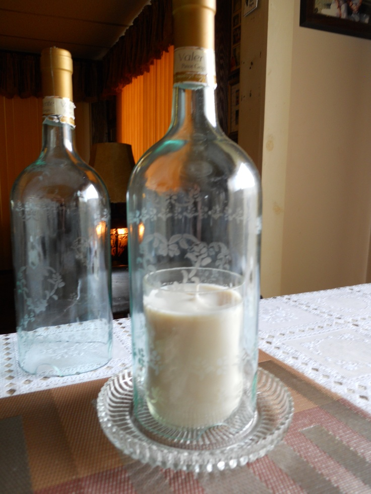 Hurricane Lamps , repurposed wine bottle candle is Soy no scent or dye and  stencil is acid etch in glass on both candle glass and hurricane lamps