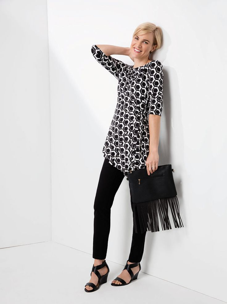 Mix it. Match it. the mock wrap geo print tunic dressed down by pairing it twill pants or slim leg denims.