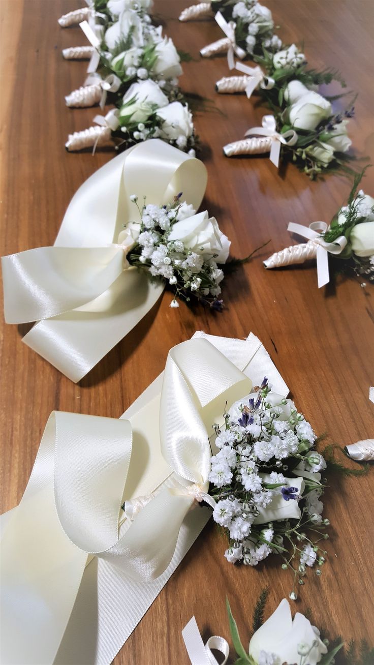 Elegant, soft, simple corsages for special ladies of the wedding party.  baby's breath, white spray roses, lavender, fern...