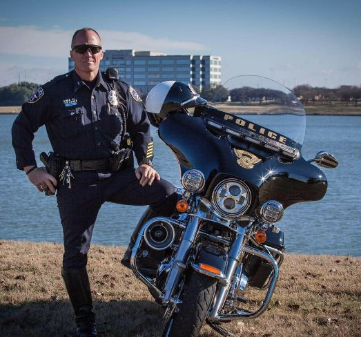 IRVING, Texas – The grieving widow of a police veteran re-visits the site of his death with purpose. Mark Dahl (pictured), a 19-year veteran with Irving Police Department, was riding his motorcycle to work on August 12, 2016. He hit a curb at the intersection of Valley View Lane and Interstate 635. Mark didn't make it to work that day, nor did he make it home . . . ever!   http://www.lawenforcementtoday.com/grieving-widow-revisits-site-husbands-death/
