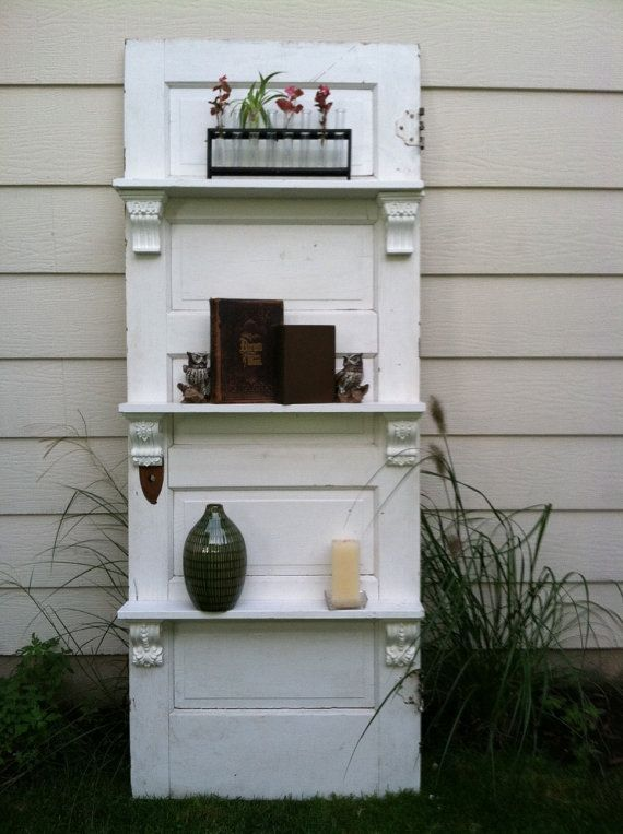 I am not sure where I found this but it is an excellent idea. Take a door, attach some nice looking shelf brackets, add shelves and paint. Awesome!