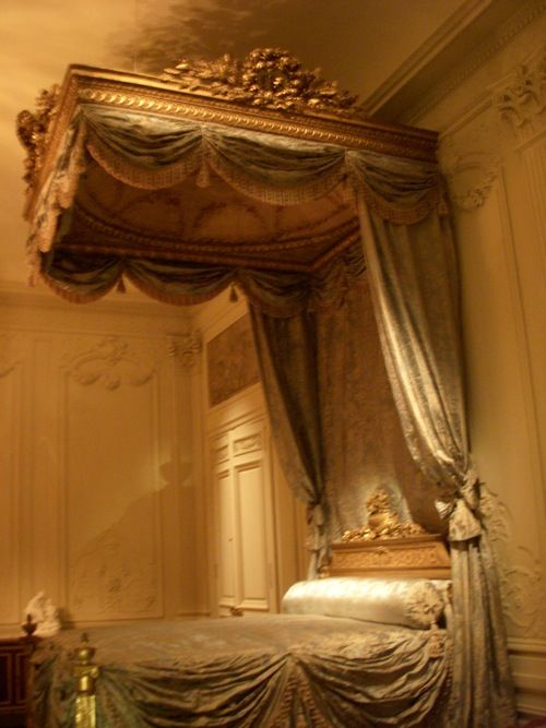 The ceilings in this bedroom must be very, very tall.  That canopy is amazing!  Very French!  Love!
