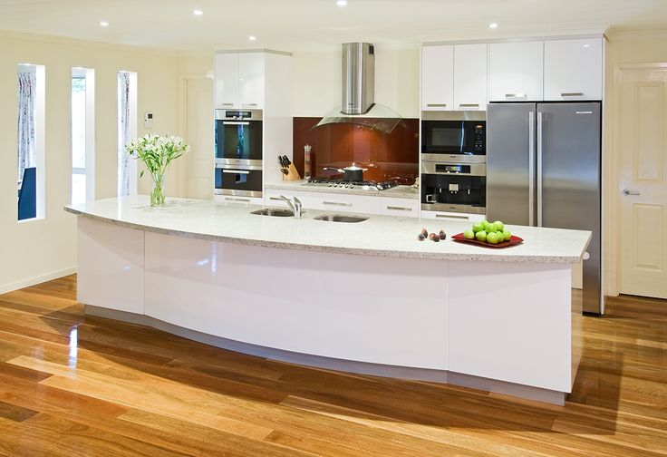 An abundance of light, highlights the long workable surfaces and fresh gloss white doors and panels of this gorgeous kitchen.