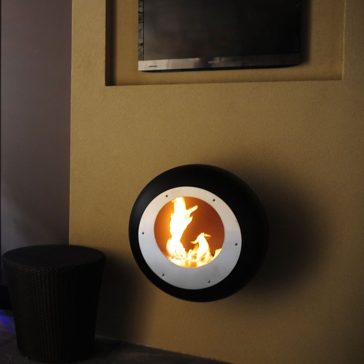 Vellum wall mounted cocoon fireplace