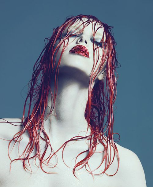 Wet hair, dramatic makeup, minimal styling and model pose (head tilted back, looking down)