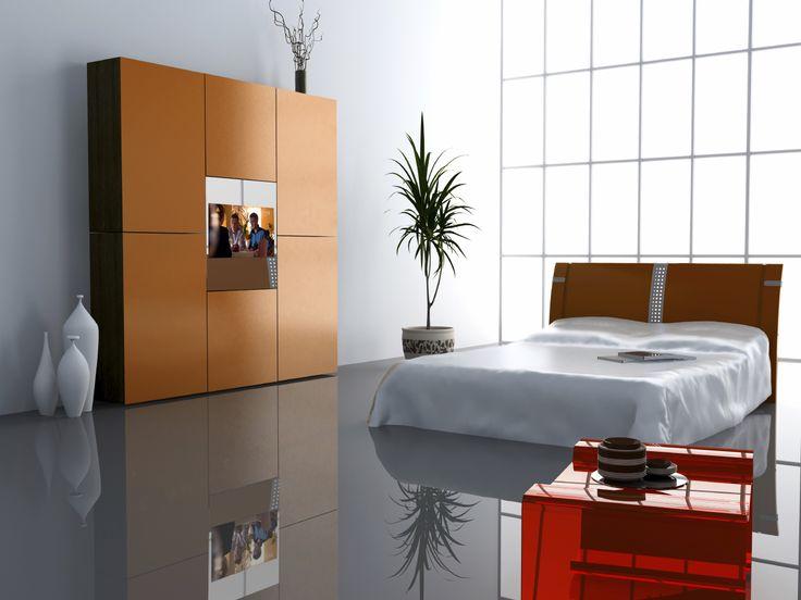 Telewizor w sypialni ukryty w lustrze zabudowanym w szafie. Podobne pomysły na: http://mirrormultimedia.pl/projektowanie-wnetrz/aranzacja-sypialni #mirrortv #tvinthebedroom
