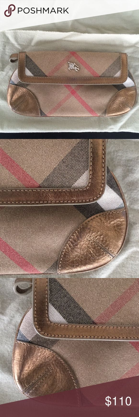 Burberry Clutch/wristlet Beautiful Burberry convertible clutch/wristlet with slight shimmer/metallic sheen. Minor wear on interior. Exterior is in excellent condition. Comes with original duster bag Burberry Bags Clutches & Wristlets