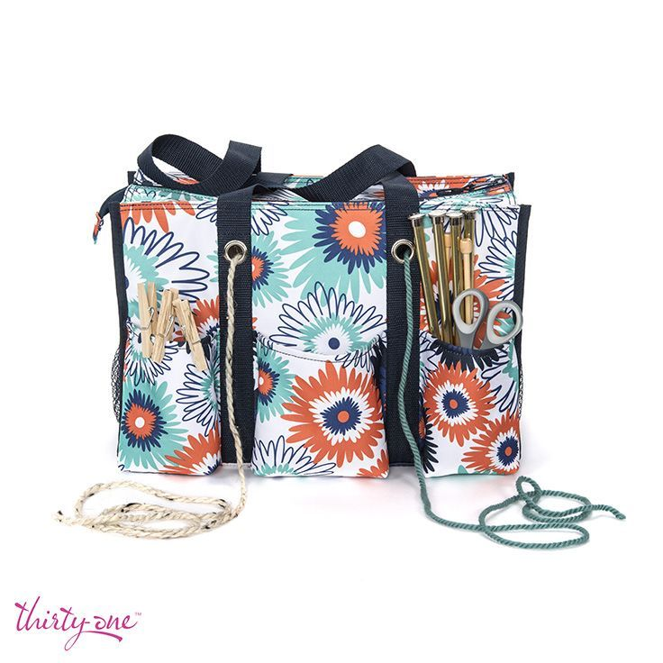 Our Zip-Top Organizing Tote is the perfect knit kit. String your yarn through the grommets to keep your skeins free from tangles and knots.